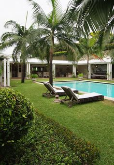 Patio and yard with poolside lounge