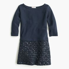 A cozy knit dress with three-quarter sleeves and a quilted skirt with sparkly sequins is the one she'll want to wear all the time (and since it's machine washable, she totally can). <ul><li>Shift silhouette.</li><li>Falls above knee.</li><li>Cotton.</li><li>Machine wash.</li><li>Import.</li><li>Online only.</li></ul>