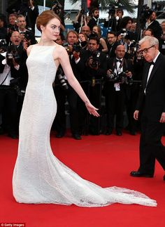 Leading the way:The actress cut a demure figure in a slinky white dress for her big night...
