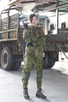 Airsoft Player in Japan. Fashion Photo Woman. Wearing a Pencott GreenZone camo…