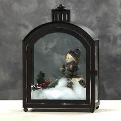 Google Image Result for http://www.candlelightsolutions.com/images/show29-2__Curvy_top_metal_lantern_and_snowman_christmas_table_centerpiece.jpg