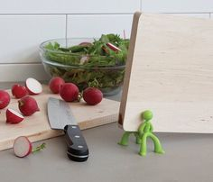 Keep your kitchen top as tidy as ever by stocking your cutting boards on this adorable Board Brothers Cutting Board Holder.