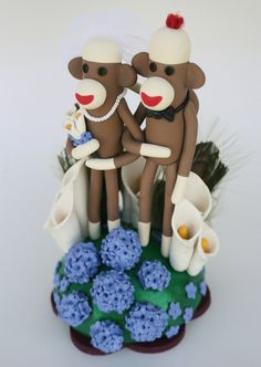 """Sock Monkey Wedding Cake by """"SpiritMama"""" on Flickr --- My friend Chelsea would love this, almost as much as the Tim Burton movie cakes!! Love the hydrangeas and cala lillies. Very festive for summer!"""