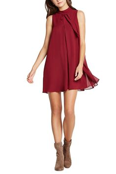 High neck trapeze dress. Has an all over sheer layer for beautiful movement and a tie at front neckline. Is an easy silhouette for all figures and would look great with a belt!   High Neck Dress by BCBGeneration. Clothing - Dresses - Casual Clothing - Dresses - Cocktail Montana