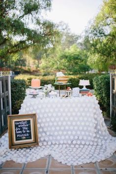 pretty bridal shower setting to serve sweet treats using a white billowing tablecloth see more
