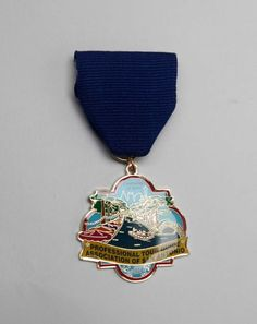 Professional Tour Guide Association of San Antonio's Fiesta Medal featuring the San Antonio River is