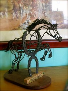Let this horse jump into your living room or trophy case! Horse Jumping thru horseshoes made with recycled wire by Ponyart, $165.00