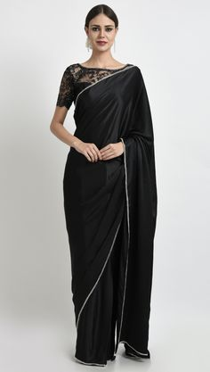 This is a Black Pure Satin Silk saree with handcrafted Swarovski crystals on lace blouse and crystal embroidered borders all around saree. The saree is finely finished with black pure crepe trimmings. The chic lace blouse is embellished with Swar Lace Saree, Satin Saree, Sari, Saree Dress, Lehenga Choli, Silk Satin, Anarkali, Silk Sarees, Saree Backless