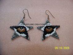 Star Earrings with wolf eye by EagleplumeCreations on Etsy