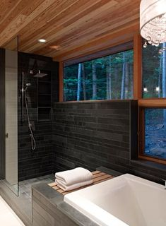 a single spotlight lights the shower space while a crystal chandelier provides the perfect ambiance for a bubble bath.