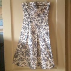 Girly Strapless Floral Dress This is a lovely navy and white floral dress. It is strapless and flows outward around the waist. It looks great on! Dresses