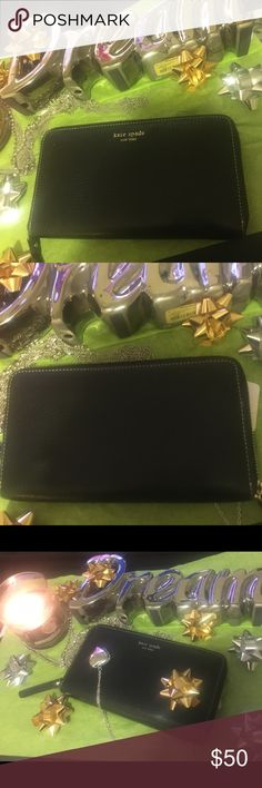 ♠️FINAL PRICE♠️Price goes back up at 3AM EST This ♠️ Kate Spade ♠️ black leather wallet clutch zips on three sides and opens to a spacious wallet that has many credit card slots on each side a zippered coin pocket splits this wallet into two separate sides store your phone etc. There are two bigger pickets behind the credit card slots on each side. Matches EVERYTHING!!! This was really expensive for me you are getting a great deal. And I'm taking a huge loss since it was used once. PRICE…