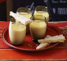 Lemon posset with sugared-almond shortbread. Making your own, individual citrus set puddings is even more impressive when served with homemade biscuits for scooping out the cream