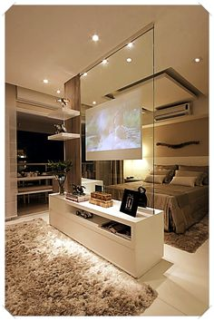 Modern contemporary luxury white master bedroom with TV inside a glass panel ! Sexy, cool and wonderful! Double bedroom dream house luxury home house rooms bedroom furniture home bathroom home modern homes interior penthouse Tv In Bedroom, Master Bedroom Design, Master Bedrooms, Bedroom Furniture, Furniture Plans, Bed Room, Luxury Master Bedroom, Fancy Bedroom, Master Suite