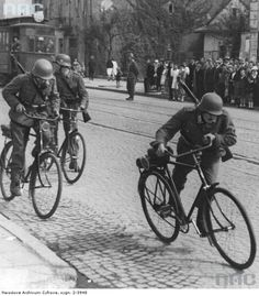 A Wehrmacht patrol rides their bicycles through the captured Polish capitol of Warsaw during a customary patrol. Poland, 1939.