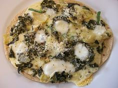 Spinach Artichoke Pizza on a Tortilla. oh my yum.  the world according to eggface