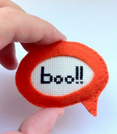 cross stitch in felt conversation bubble by Gluck.  I love this idea for finishing a small stitch