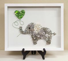 The Elephant Jungle Animal series features a heart shaped balloon to express love. Each beautifully made custom piece comes framed on a 11 x 14 white canvas. This unique piece of decor will add a special design touch to any nursery or childs room. Great gifts for baby showers, expecting parents, childrens birthdays, or just because! A variety of button colors and images are available. Please email me to discuss a piece we can create just for you! Once we have designed a custom order, I…