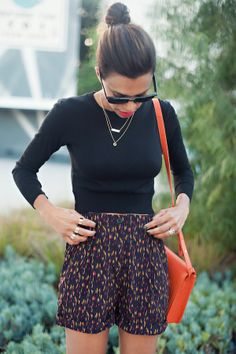 weekend ready | black cropped sweater, printed high waist shorts, printed flats, delicate jewelry, pop of orange purse
