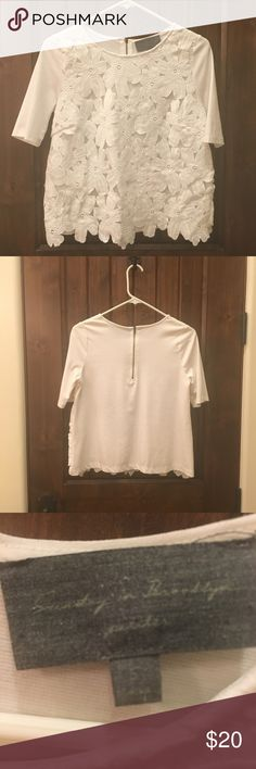 Small Anthropologie top Small Anthropologie white top with floral design. In excellent condition- like new - as only worn once. Anthropologie Tops
