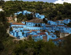 """The small village of Juzcar, in Spain's Malaga region, has recently been painted blue as part of a global promotion for the Sony Pictures film """"The Smurfs Malaga Spain, Travel Around The World, Around The Worlds, Smurf Village, Disney Princess Cartoons, Blue Curacao, Abstract Backgrounds, Adventure Time, Townhouse"""