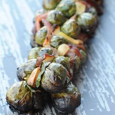 Grilled veggie masterpiece: Brussels sprouts weaved with bacon, garlic and lemon!  via @girlscangrill