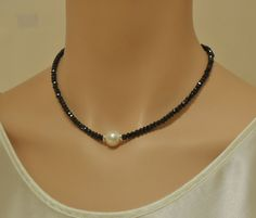 Black spinel necklace with freshwater pearl and by SilverSerenade