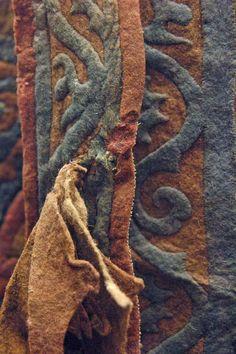 Saddle-blanket (shabrack). Pazyryk, Altai, Barrow no. 5, 252-238 BCE. 2nd riding outfit, felt. 70 x 236 cm. Pub.: Rudenko 1953, p. 208; pl. CI; Rudenko 1970, p. 169; pl. 160; Charriиre, fig. 120.