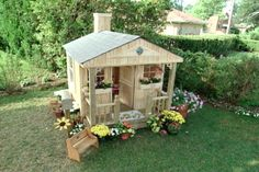 Build an outdoor child's playhouse with basic building materials and create a space for your children that they can call their very own.