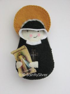 SaintlySilver's etsy shop is fabulous.  I have ordered saint softie patrons for all my children.  St. Therese and St. Gianna are especially cute.  This St. Faustina makes my heart happy.  Jesus, I trust in You!