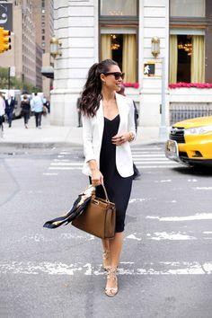 Kat Tanita of With Love From Kat wears a simple black slip dress, Theory white silk blazer, Aquazzura lace up sandals, and Fendi peekaboo bag.