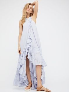 Wrap Around Maxi Dress | Made from our semi-sheer and gauzy Endless Summer fabric, this shapeless maxi wrap dress features a ruffled hem and a high crisscrossed neck with hip pockets. Open slit in back with an adjustable tie accent at the back neck.