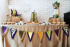 Mardi Gras Party Planning.  I like the bunting in front of the table.