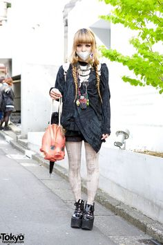 When we met Mio on the street in Harajuku, she was wearing a top she borrowed from her mother with a Grimoire skirt, graphic tights, and #Tokyo #Bopper platforms. Her doll head bag and illustrated backpack are both from #文化屋雑貨店 #BUNKAYA #ZAKKATEN in Harajuku. Mio's full look - with closeups of her countless accessories - is here: http://tokyofashion.com/grimoire-tokyo-bunkaya-zakkaten.../ #tokyofashion #street snap #Harajuku