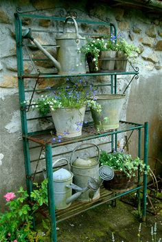 old watering cans ~ I would like this outside by the various water service areas just for this purpose ~ to store watering cans and pots etc. I have a lot of watering cans usually three at each faucet. Three at each sitting area ~ so there is always a 'drink' for plants needing one. ~Sandra De~