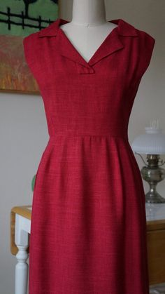 Description This 1950s Adele Simpson dress is beautifully made. Fashioned of a red raspberry linen and fully lined in silk, the dress features a