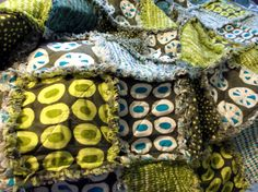 Bold patterns that remind me of olives and tomatoes. Greens, blues, and grays. A comfy rag blanket to fit any adult, teen or child.