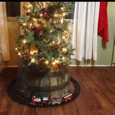 I like the idea of the barrel instead of a tree skirt.