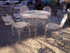 Vintage Distressed Metal Patio Set   Table and Four Matching Chairs  Great shabby chic look with mid century circle design.  $495  Country Garden Antiques 147 Parkhouse  Dallas, TX 75207  Read more: http://dallas.ebayclassifieds.com/outdoor-garden/dallas/vintage-distressed-metal-patio-set/?ad=31031881#ixzz2nzpJSsIS