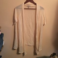 BCBG short sleeved open cardigan L Cream , short sleeved open cardigan. Tapers longer in front BCBG Sweaters Cardigans
