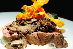 <p> Carrot-chip ribbons are a popular and easy-to-make garnish, as seen here atop a roast tenderloin of beef with horseradish...