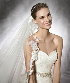 DAGEN- This original lace dress is an outstandingly elegant choice for such a special day. This spectacular A-line gown has a heart-shape neckline and flowing skirt with godets.