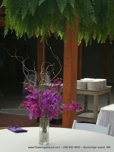 A picture of a Kiana Lodge Wedding. I would love the centerpieces to accent the natural ferns in the eating area