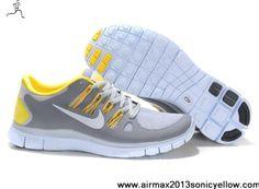 promo code b4daf 789f6 Baskets à lacets Unisex Femmes Nike Free Run Gris Jaune