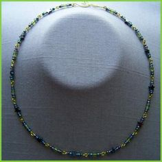 Peridot Hematite Star Necklace by AthomicArtandDesign for $10.00