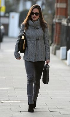 4eb4ff1c467 Pippa Middleton street style  Pippa cozied up with a high-neck winter  jacket.