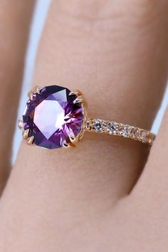 Some gems just leave us spellbound--like this insane fireball of mature purple and pink lustrous spinel. I set it oh so low to the finger with hand-engraved pave set diamonds to accompany the center gem. Galleries of swirling spirals erupt from a custom vintage-inspired setting for a perfect vintage meets modern look. It's powerful. Strong. Feminine. Budget Friendly Engagement Rings, Spirals, Hand Engraving, Solitaire Engagement, Purple, Pink, Galleries, Vintage Inspired, Finger