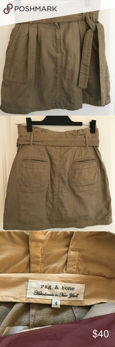 """Rag and Bone Khaki """"Paper Bag"""" Skirt Rag and Bone Khaki """"Paper Bag"""" Skirt. Size 4 but fits more like a size 2 or a larger size 0. Pockets in front and back. Belt is detachable. The back looks a little wrinkled because I did not iron prior to taking the photo. With a quick ironing, there are no wrinkles. This skirt is in perfect condition and a wardrobe staple! Just doesn't fit me anymore, and it's looking for a forever home. rag & bone Skirts Midi"""