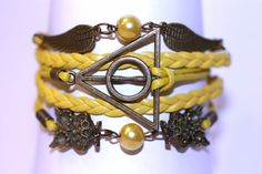 Deathly Hallows Hufflepuff Bracelet | Community Post: 25 Gifts Hufflepuffs Will Find Particularly Enchanting