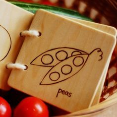 thinking of making a little (5 page or so) wooden book ... simple drawings of animals, food, faces...